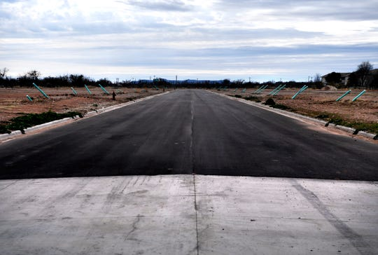 A new road separates lots ready for development in a future neighborhood off U.S. Highway 277 Tuesday.