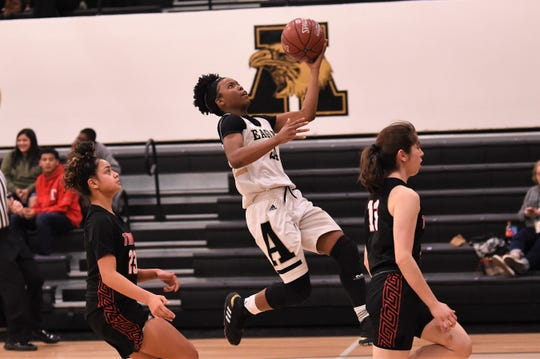 Abilene High's Trakenya Roberson (24) goes up for a layup against Euless Trinity at Eagle Gym on Tuesday. The Lady Eagles got off to a slow start in the 67-42 loss.