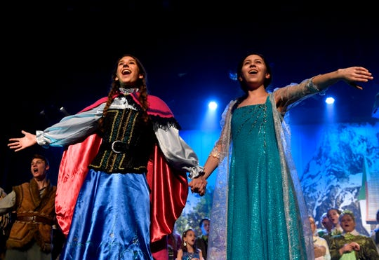 Katie Moore (left) and Anna Claire Boone perform as sisters Anna and Elsa in Disney's Frozen Jr. at the Paramount Theatre during rehearsal Tuesday Jan. 21, 2020.