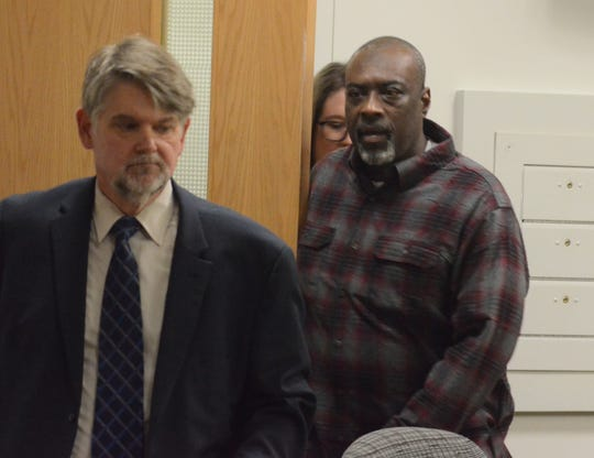 Otha Carroll, center, enters the courtroom with his attorneys, Niels Magnusson and Kim Wickham