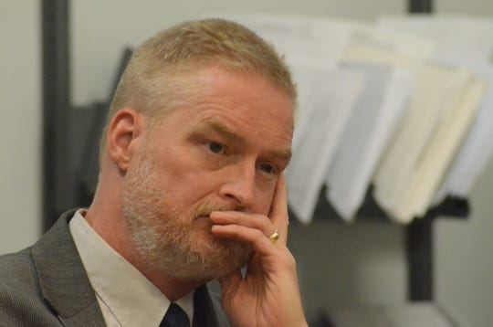 Dr. Mark Walker listens to testimony on Tuesday.