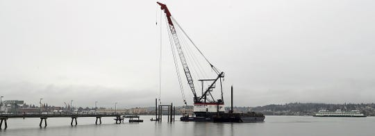 An American Construction crane works at the site of the Annapolis Ferry Dock expansion in Port Orchard on Wednesday, Jan. 22, 2020.