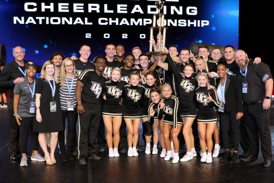 The national champion UCF Knights cheerleading team strikes the winning pose.