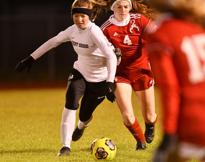 Maci Pekmezian of West Shore is challenged for the ball during a game.