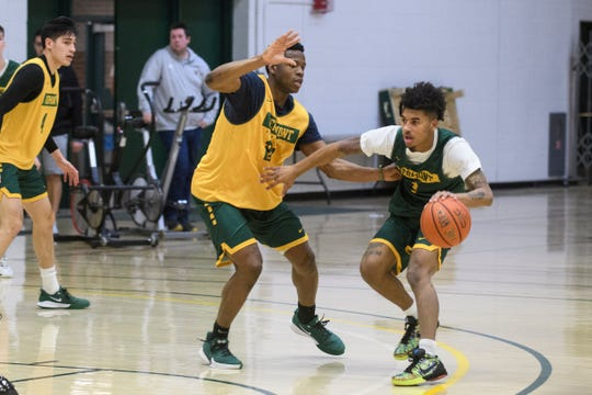 Vermont's Ben Shungu (24) guards Aaron Deloney (1) during the Vermont Catamounts men's basketball practice at Patrick Gym on Tuesday January 21, 2020 in Burlington, Vermont.