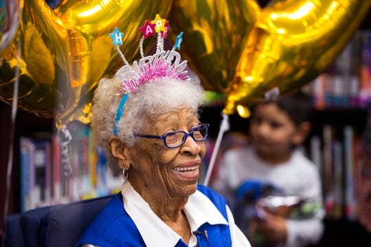"""Conster """"Granny"""" Davis is surprised with a 100th birthday party in the Galvan Elementary School library. Granny has volunteered for the school district for 25 years and for 10 years at the school."""
