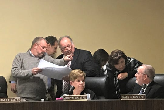 Members of Cherry Hill's planning board consider proposed changes to the former Garden State Park during a break in Tuesday night's meeting.