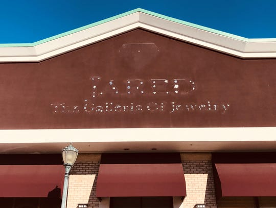 A facade shows a faint reminder of Jared The Galleria of Jewelry in a shopping center at the former Garden State Park racetrack.