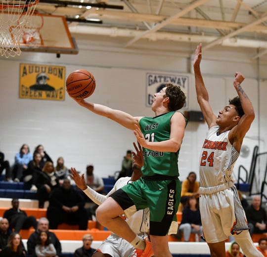 West Deptford's Brandon Ratcliffe makes a layup during Tuesday's basketball game against Overbrook. The visiting Eagles topped the Rams 61-56 on Jan. 21, 2020.