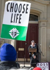 Angela Pridemore of Mercy Home talks to several people gathered outside of the Ross County Courthouse for the third annual march for life on Jan. 22, 2020.