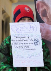 A young participant stands on the Ross County Courthouse steps with a partially home-made sign during a Right to Life rally in Chillicothe on Jan. 22, 2020.