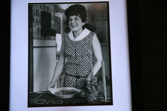 Norma Antenucci, Chrissy's grandmother, cooking in her home kitchen.