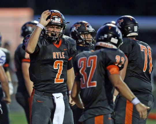 Ryle QB Tanner Morgan [2] high fives RB Cole Burch after completing a two-point conversion in the first half.