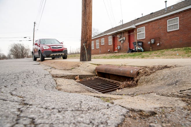 The gradual sinking caused by sewer and plumbing problems creates bad roads at Lincoln Homes public housing community in Clarksville, Tenn., on Wednesday, Jan. 22, 2020.