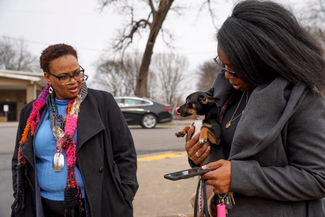 Michael Daniels holds a stray puppy she and Patricia Tyus, left, named Lincoln in tribute to where he was found at the Lincoln Homes public housing complex in Clarksville, Tenn., on Jan. 22, 2020.