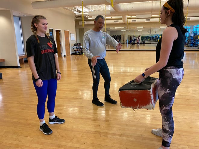 Malcolm Rowley (center), Krav Maga instructor at Nava Martial Arts in Plainfield and owner of Mountain Fitness in Warren, shows self-defense techniques to Julia Weniger (left) and Reese Lewin.
