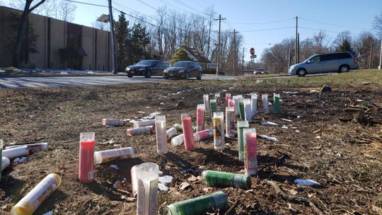 A large group of candles at a memorial along Route 22 in Mountainside where two Plainfield teens died on Jan. 12.