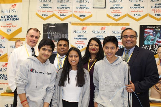 (Back left to right) Dr. John Bucek, Dr. Vipul Mody, Dr. Anju Rustagi, Dr. Sharan Mahal, (front left to right) SCVTHS freshman Aarush Kumar of Hillsborough, Jiya Mody of Martinsville and Milan Patel of Franklin Park pose for a photo after the panel discussion.