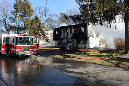 The roof of the home collapsed during the fire, according to a police monitoring service.