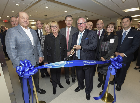 Participating in a ribbon cutting ceremony for Robert Wood Johnson University Hospital Somerset's 1-East Geriatric Unit on Jan. 21 were from left to right, Tom Biga, president, Hospital Division, RWJBarnabas Health; Jack Morris, chairman, Robert Wood Johnson University Hospital Board of Trustees and RWJBarnabas Health Board of Trustees; Glenn Miller, executive vice president and chief development officer, RWJBarnabas Health; Amy Mansue, executive vice president and chief experience officer, RWJBarnabas Health; Suzanne Kalafer; Paul Hubert, chair, Somerset Health Care Foundation Board of Trustees; Steve Kalafer, chairman of the Somerset Patriots, owner of the Flemington Car & Truck Country Family of Brands and former chair of Somerset Health Care Foundation; Tony Cava, president and CEO, Robert Wood Johnson University Hospital Somerset; Barry Ostrowsky, president and CEO, RWJBarnabas Health; Jo-Ann Mendles, chair, Robert Wood Johnson University Hospital Somerset Advisory Board; and Josh Kalafer, co-chairman of the Somerset Patriots and co-owner of Flemington Car & Truck Country.