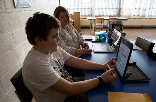 Cooper Williams works on reading skills using an iPad with Julie Dearyan his dyslexic tutor. In the past year Williams grades have gone up significantly because of the tutoring.