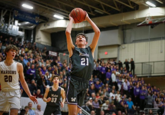 Waukee freshman Pryce Sandfort goes up for a quick field goal against Dowling Catholic on Tuesday, Jan. 21, 2020, at Dowling Catholic High School in West Des Moines.