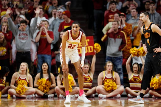 Iowa State guard Tyrese Haliburton (22) reacts in front of Oklahoma State guard Thomas Dziagwa, right, after making three-point basket during the first half of an NCAA college basketball game, Tuesday, Jan. 21, 2020, in Ames, Iowa. (AP Photo/Charlie Neibergall)