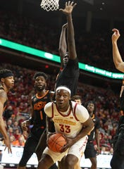 Jan 21, 2020; Ames, Iowa, USA; Iowa State Cyclones forward Solomon Young (33) looks for an opening against the Oklahoma State Cowboys defense at Hilton Coliseum. Mandatory Credit: Reese Strickland-USA TODAY Sports