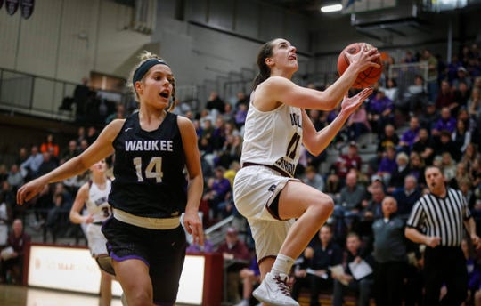 Dowling Catholic senior Caitlin Clark drives up for an easy layup against Waukee on Tuesday, Jan. 21, 2020, at Dowling Catholic High School in West Des Moines.