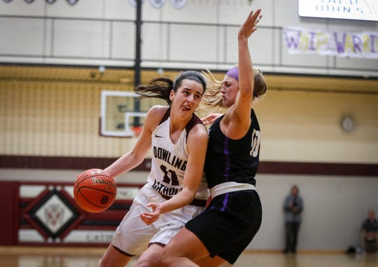 Dowling Catholic senior Caitlin Clark drives to the basket against Waukee on Tuesday, Jan. 21, 2020, at Dowling Catholic High School in West Des Moines.