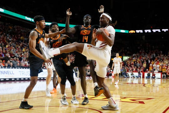 Iowa State forward Solomon Young, right, grabs a rebound in front of Oklahoma State forward Yor Anei (14) during the first half of an NCAA college basketball game, Tuesday, Jan. 21, 2020, in Ames, Iowa. (AP Photo/Charlie Neibergall)