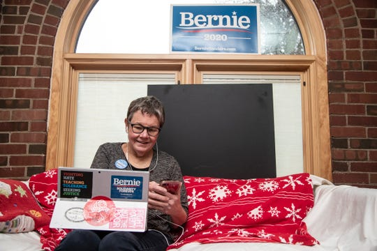 Susan Steigerwalt of Detroit, speaks to a potential voter during phone bank hour from her home in Detroit, Saturday, Jan. 11, 2018.