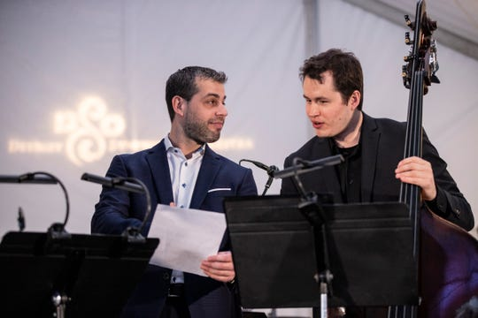Jader Bignamini, Detroit Symphony Orchestra music director, center, talks to Kevin Brown, DSO's principal bass before the Love at First and 2020-21 Season Celebration Event at Beacon Park in Detroit, Wednesday, Jan. 22, 2020.