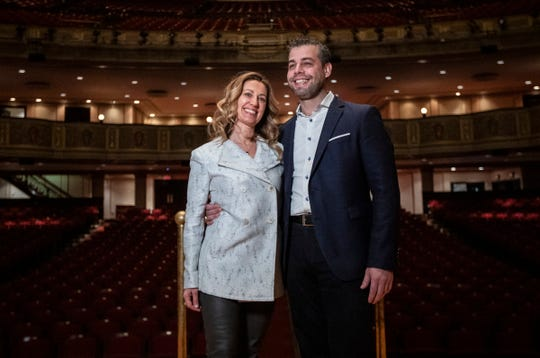 Jader Bignamini, Detroit Symphony Orchestra's new music director poses for a photo with his wife Lidia on stage at the Orchestra Hall in Detroit, Tuesday, Jan. 21, 2020.