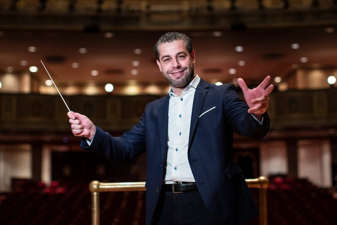 Jader Bignamini, Detroit Symphony Orchestra's new music director poses for a photo on stage at the Orchestra Hall in Detroit, Tuesday, Jan. 21, 2020.
