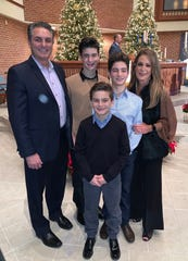 The Carroll family was reeling when the breadwinner was fired in January 2019 without warning, then he came up with a plan. Brian Carroll, left, with his wife, Angela, and their sons (back to front) Benny, Dominic and Sammy at Christmas Eve mass at St. Peter's Lutheran Church in Macomb in 2019.