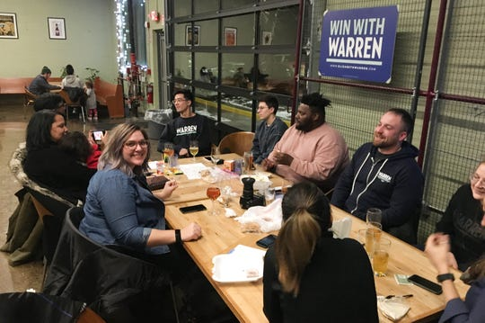 About a dozen people gathered at Brewery Faisan in Detroit in January to talk about what they can do to boost U.S. Sen. Elizabeth Warren's presidential bid before Michigan's March 10 primary election.