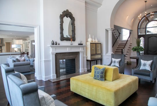 The  ceiling in the formal living room follows the same arch as the foyer and the front door, at right. Out of sight here, at far left, a tall, wide window has the same arch.