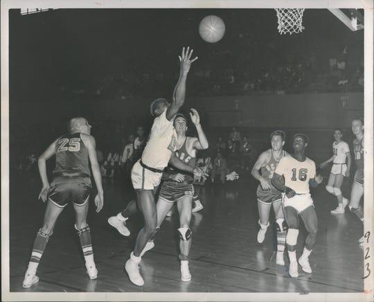 Wayne State's Charlie Primas, in white, flips a shot toward the basket after eluding Santa Barbara.