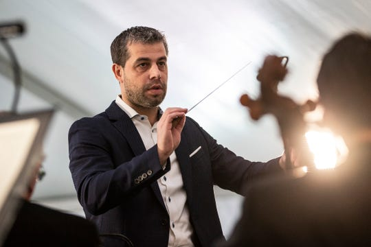 Jader Bignamini, Detroit Symphony Orchestra music director, warms up with musicians before the Love at First and 2020-21 Season Celebration Event at Beacon Park in Detroit, Wednesday, Jan. 22, 2020.