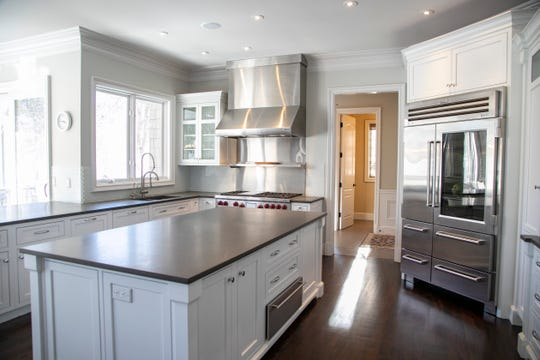The 20-by-20-foot kitchen has lavish counter space -- an island plus four more granite counters all 8 to 10 feet long.