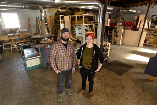 Long White Beard co-owners Dan Erickson, left, and Shelby Holtzman stand in their 3,000 square foot warehouse in Ferndale. There's a small showroom in the front. Erickson and Holtzman started the company in 2014 with Holtzman, a self-taught woodworker, making furniture out of her garage.