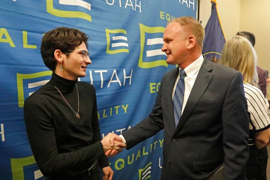 Nathan Dalley, left, shakes hands with Republican Utah Rep. Craig Hall following a news conference about the discredited practice of conversion therapy for LGBTQ children, now banned in Utah Wednesday, Jan. 22, 2020, at the Utah State Capitol, in Salt Lake City. Dalley under went so-called conversion therapy.