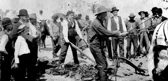Pingree, holding the plough, breaks ground for the construction of Grand Boulevard on Aug. 10, 1891.