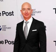 "In this Dec. 14, 2017, file photo, Jeff Bezos attends the premiere of ""The Post"" at The Newseum in Washington."