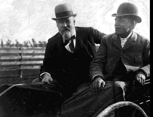 Mayor Pingree and Capt. Cornelius Gardener, who managed the potato patch program, tour the urban farm patches.