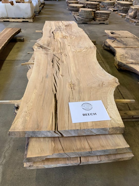 A stack of beech slabs, each one flattened to give it a deeper sanding and smooth out edges, rests on the warehouse floor at Live Edge Detroit. The firm sells roughly a dozen different hardwood species, including red oak, white oak, black walnut, beech, black locust, ash and elm.