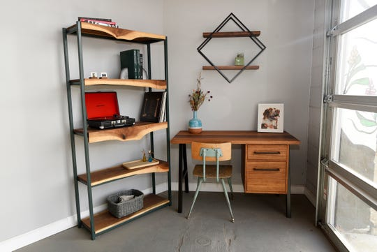 A custom bookshelf, desk and wall-mounted shelf stand in Long White Beard's showroom. More than 70% of what the studio makes is custom.