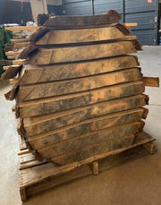 A log at Live Edge Detroit is cut into slabs that are then each assigned a letter. DIY-ers or furniture makers can pick two slabs from the same log so they'll have the same markings.