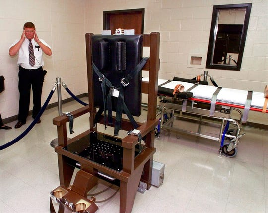 In this Oct. 13, 1999, file photo, Ricky Bell, then the warden at Riverbend Maximum Security Institution in Nashville, Tenn., gives a tour of the prison's execution chamber.